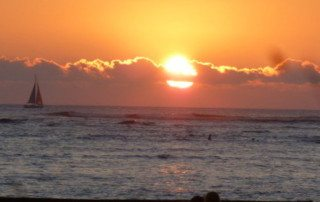 A beautiful red sunset in Hawaii, giving peace to a survivor