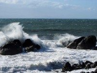 The Pacific churns against rocks creating large swells as survivors' anger turns towards themselves